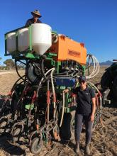 Nutrian Liquids Fertilisers researcher Andy Webster (top) and assistant Cassidy Chambers, Primaries CRT Midland, prepare a Ausplow DBS and Multistream trial seeding rig, used to assess liquid and granular nutrients and ameliorants.