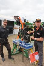 Ausplow engineering manager Carl Vance (left) and marketing and sales manager Chris Blight were kept busy during the field days as they fielded questions from farmers about the company's R&D to develop a liquid delivery system for in-row or edge-row applications using Friction Flow tubing from Furrow Management Systems.