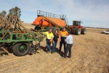 East Latham farmers Mark (left) his wife Suzanna and son Tom talk with Boekeman Machinery Dalwallinu salesman Wayne Stoner.
