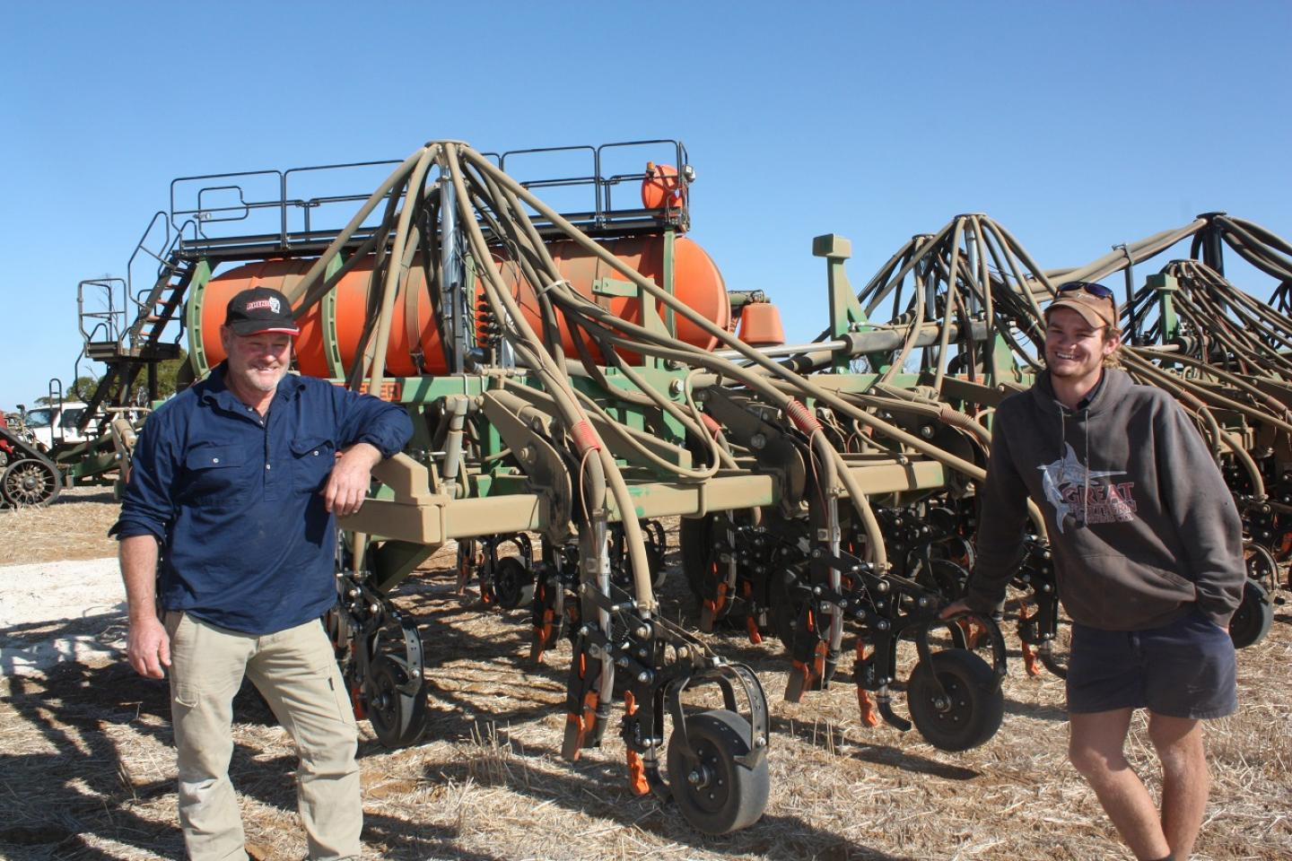Kondut farmer Tyler Latham (right) and tractor driver Gil Phillips, Ballidu, take a break during a recent canola program employing a new Ausplow seeding rig and a new Case IH Steiger Quadtrac 550, bought from Boekeman Machinery, Wongan Hills.